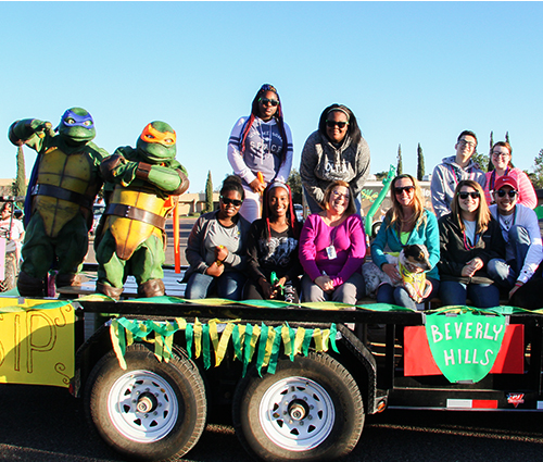 Students In Philanthropy on a roll in MC Homecoming parade